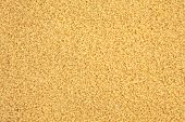 Bulgur wheat grains forming a textured background.