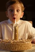 pic of ear candle  - kid posing when blowing birthday candle - JPG