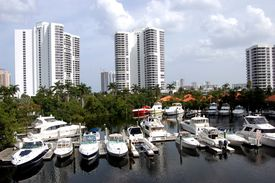 stock photo of high-rise  - Panoramic view of a north Miami Beach marina and high rise condominiums - JPG