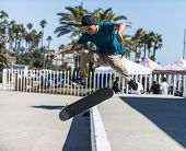 OCEANSIDE, CALIFORNIA - AUGUST 19: Skateboarder Alex Garcia practices aerial tricks on his board on