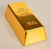 Studio Shot Of 1kg Gold Bar Isolated On�?�?�?� Texture
