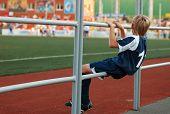 Stand By Boy In Sport Uniform In Stadium