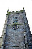 A Clocktower Of A Stone Building