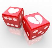 Two hearts on dice, one broken to symbolize the risk in love, dating, relationships, marriage and di
