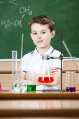 Little chemist holds an experiment