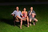 three friends in exterior cinema