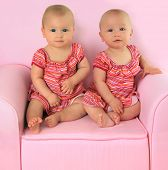 Identical twin baby girls, 10 months old.