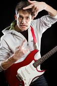 Man with red electric guitar, playing solo