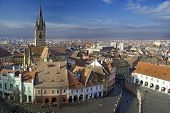 pic of mica  - Aerial view of Sibiu old town in Transylvania Romania Lutheran cathedral tower and Small Square  - JPG