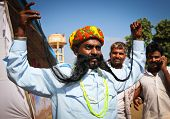 PUSHKAR, INDIA - NOVEMBER 18: Unidentified contestant in moustache contest at Pushkar fair.  Pilgrims & traders flock to the holy town for the annual fair.  Nov 18, 2010 in Pushkar, Rajasthan, India