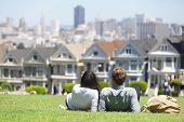 San Francisco - Alamo Square people. Couple in Alamo Park by the Painted Ladies, The Seven Sisters,