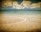 stock photo of deserted island  - Vintage seascape of long deserted beach with golden sand - JPG