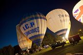 NORTHAMPTON, ENGLAND - AUGUST 18: Hot Air Balloons in night time burn demonstration at the Northampt