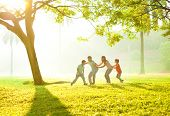 foto of family bonding  - Happy Asian family playing together at outdoor park - JPG