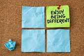 enjoy being different advice - lifestyle or nonconformist concept - handwriting on colorful sticky notes