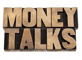 money talks - financial concept  - isolated text in letterpress wood type