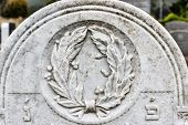 Decoration On Old Grunge Marble Tombstone