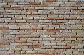 image of sandblasting  - Symmetrical wall of clay bricks red sandblasted - JPG