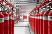 stock photo of fire insurance  - Large CO2 fire extinguishers in a thermal power plant - JPG