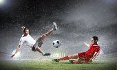stock photo of football  - Image of two football players at stadium - JPG