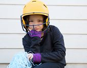 stock photo of pom-pom  - children cheerleading pom poms girl sad relaxed yellow baseball helmet - JPG