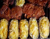 Barbecue grilled beef meat and foil potatoes prepared with cream and cheese