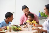 image of 11 year old  - Family Eating Meal Together At Home - JPG