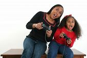 stock photo of video game controller  - African American mother and daughter playing video games - JPG