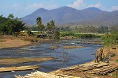 Lanscape Of Canal And Weir, Rural Road And Mountain Background, Blue Sky
