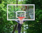 A Basketball Hoop With Glass Backboard