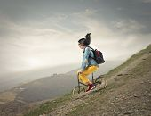 young woman on the bike downhill