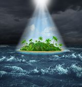 stock photo of storms  - Hope and aspirations success concept with a dark storm ocean background contrasted with a glowing light from above shinning down on a beautiful tropical island as an oasis vision of the promised land - JPG