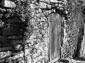 Wooden Door In Stone Wall