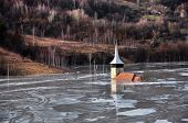 Abandoned Church In A Mud Lake. Natural Mining Disaster With Water Pollution