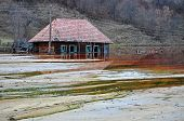 Ecological Disaster. An Abandoned Village Flooded By Polluted Water From A Mine