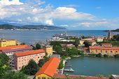 View of navy base on gulf of La Spezia under beautiful blue sky with white clouds on Mediterranean s