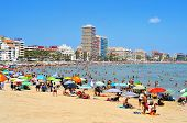 PENISCOLA, SPAIN - JULY, 26: Bathers in North Beach on July 26, 2013 in Peniscola, Spain. The town i