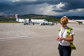 SPLIT, CROATIA - JUN 6: Airport staff standing on a runway of Split Airport during boarding on June