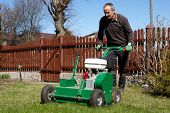 stock photo of aerator  - Spring work in garden - JPG