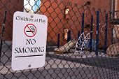 Children At Play - No Smoking As Warning Message, Sign On Metal Grid