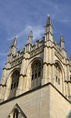 stock photo of grotesque  - Merton College chapel tower with gargoyles and grotesques - JPG