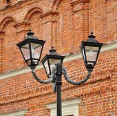 Lantern On The Red Brick Wall