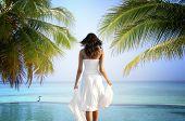 Young woman walking on idyllic beach, Maldive Islands