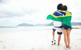 pic of flags world  - Brazil soccer fans stand on beach together with flag for world cup with ball - JPG