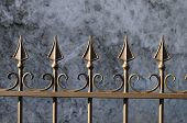Brown wrought iron gate and barriers