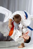 pic of judo  - Training judo throw sportsman in judogi and with blue belt