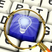 Light Bulb Key Magnified Means Bright Idea Innovation Or Inventi