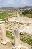 JERASH, JORDAN - MARCH 18, 2014: Tourists on the Oval Forum in the ancient city of Jerash. Since 200
