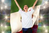 Football fan in white cheering holding mexico flag against large football stadium with brasilian fans