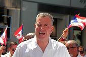 NYC Mayor Bill de Blasio with flag